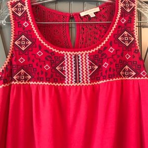 Red sleeveless blouse with embroidery detail